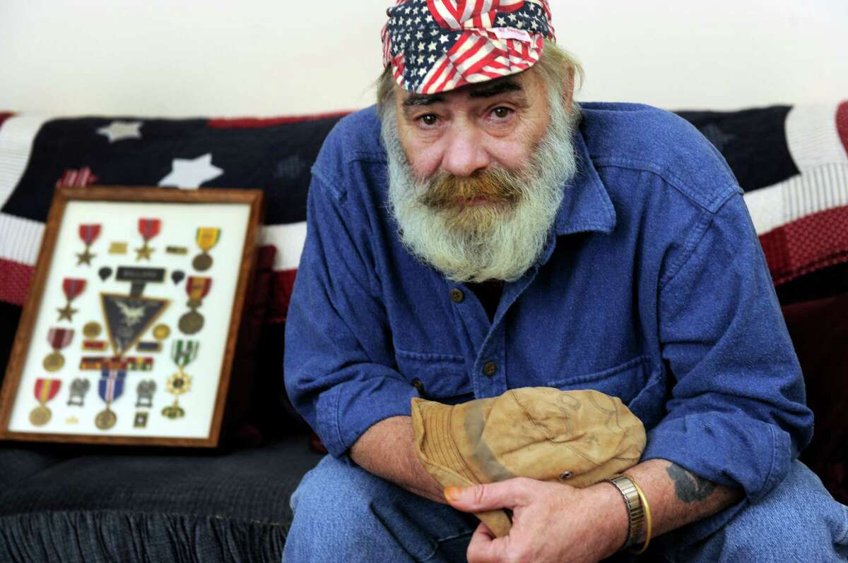 Peter Ballard, 63, a veteran of the war in Vietnam, is photographed in his home in New Fairfield, Conn., Thursday, March 5, 2015. In his hands is the boonie hat that he war during the war.