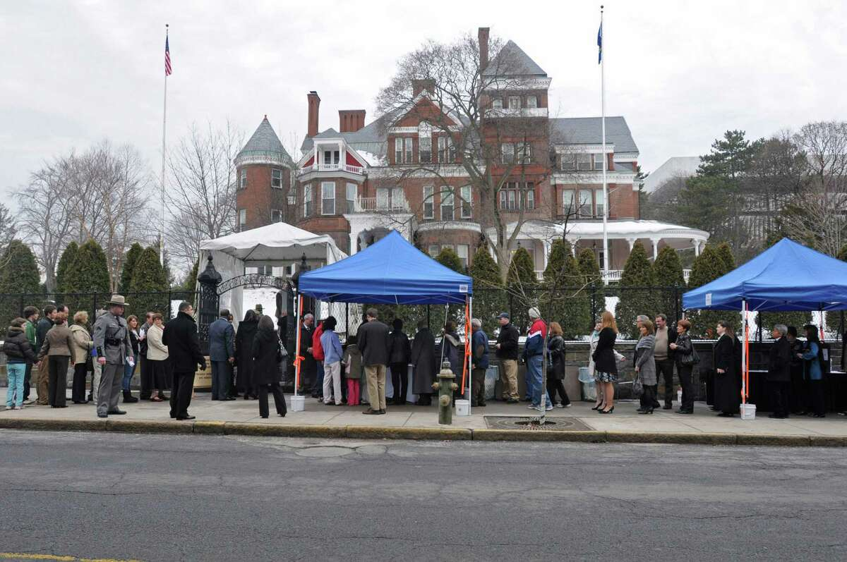People wait in line to meet Gov. Andrew Cuomo and Lt. Gov. Robert Duffy during an open house at the Executive Mansion to celebrate the New Year on Jan. 1, 2011, in Albany, N.Y. (Lori Van Buren / Times Union)