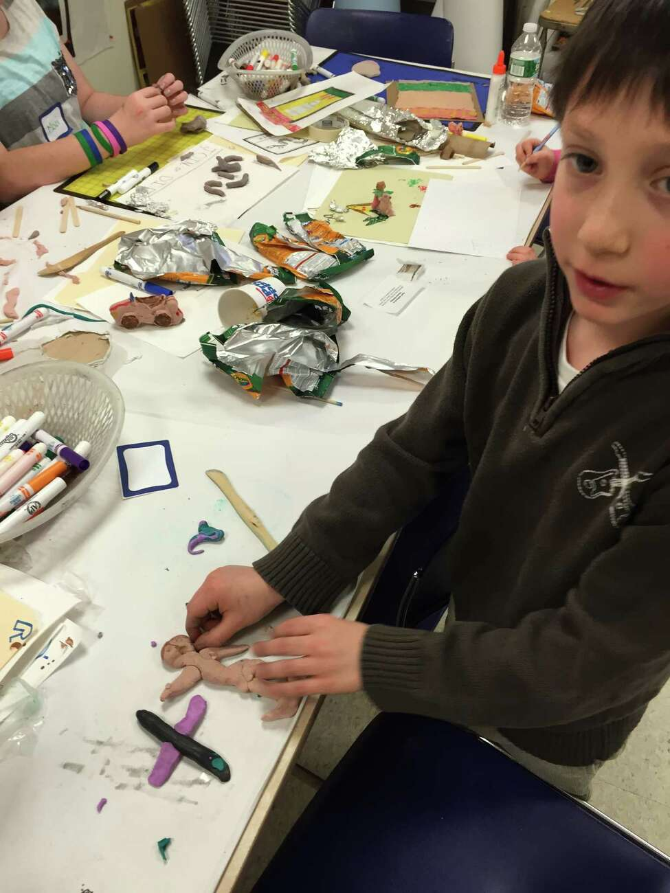 Daniel Kurtz, a third-grader at Mater Christi School in Albany, shows off a clay model of his cargo plane and pilot at the Albany Institute of History and Art's