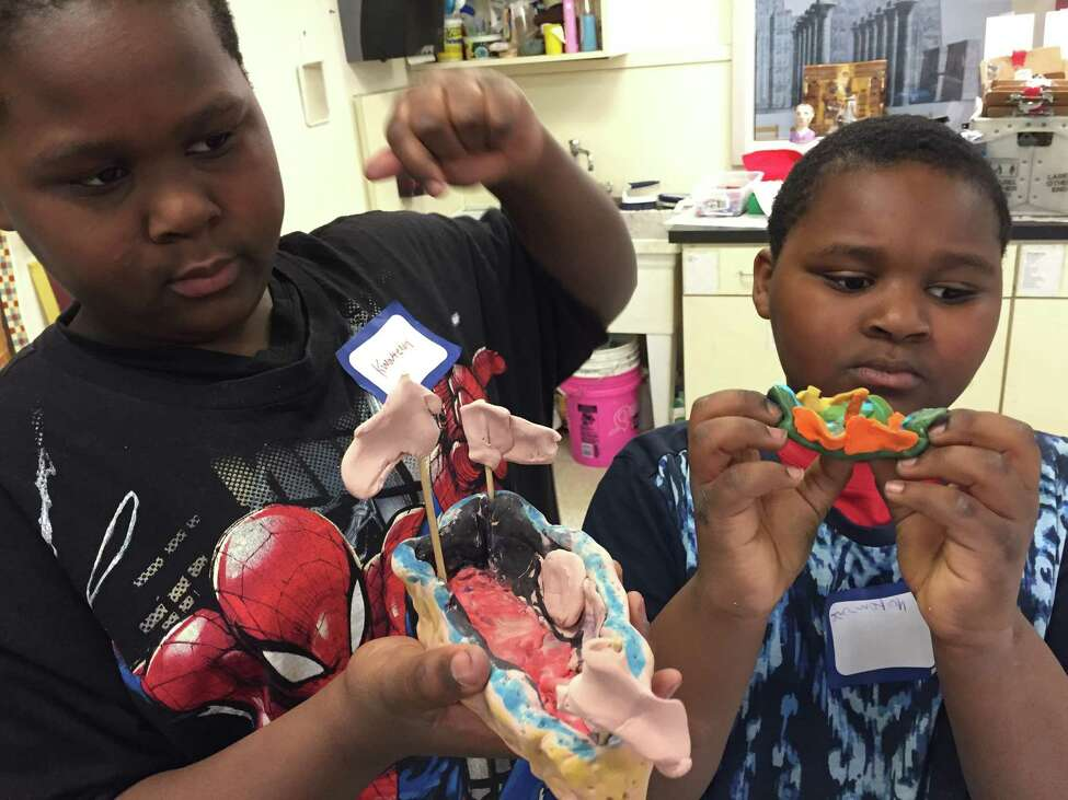 Kwaterion Perry, a fifth-grader, left, and his brother, Jaqwarion Perry, a fourth-grader, were visiting from Rochester and they showed off clay models of the 19th-century steamship Swallow at the Albany Institute of History and Art's