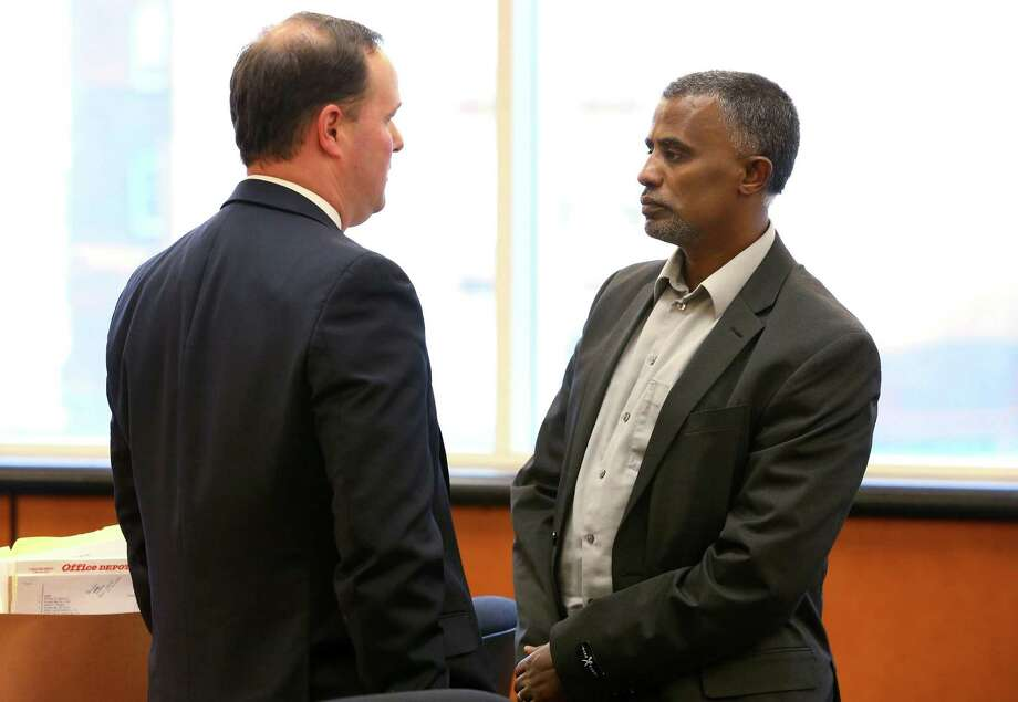 FILE - In this Dec. 2, 2015 file photo, attorney David O'Mara, left, talks with his client Fanuel Gebreyes, who is fighting to maintain life support for his 20-year-old daughter Aden Hailu, leaving a hearing in Washoe County District Court in Reno, Nev. The court fight over a Reno hospital providing life-support for Hailu goes back to court Tuesday, Dec. 29, 2015, for arguments about standards for brain death and tests to prove it. (Cathleen Allison/Las Vegas Review-Journal via AP, Pool, File) Photo: Cathleen Allison, POOL / Pool Las Vegas Review-Journal