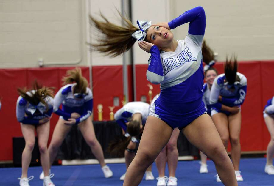 Patrice Tsopanides cheers with the Fairfield Ludlowe High School squad during the FCIAC Cheer Championships Saturday, Feb. 7, 2015, at Fairfield Warde High School. Ludlowe won the FCIAC championship. Photo: Autumn Driscoll / Connecticut Post
