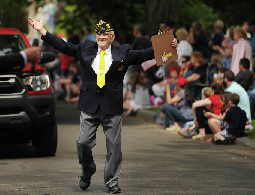 Army veteran Wayne Carson, of Milford, acknowledges the crowd after being announced from the reviewing stand at the annual Memorial Day Parade in Milford, Conn, on Sunday, May 24, 2015.