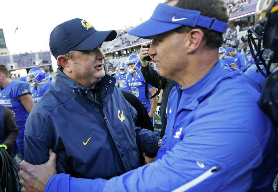California head coach Sonny Dykes, left, meets with Air Force head coach Troy Calhoun, right, following the Armed Forces Bowl NCAA college football game Tuesday, Dec. 29, 2015, in Fort Worth, Texas. California won 55-36. (AP Photo/Ron Jenkins) Photo: Ron Jenkins / Associated Press / FR171331 AP