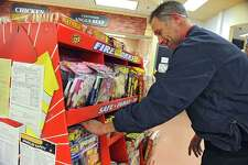 Grocery Manager John Halligan straightens up a display of fireworks at Price Chopper on Hoosick Rd. on Tuesday, Dec. 29, 2015 in Brunswick, N.Y. Fireworks such as sparklers are on sale during the New Years Eve period under a new state law. (Lori Van Buren / Times Union)