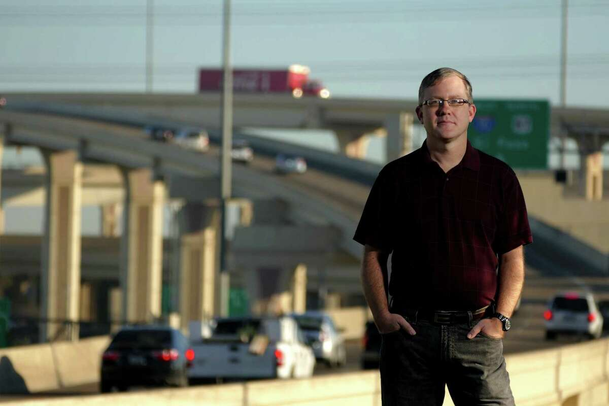 Brian Purcell, who calls himself the Texas Highwayman, keeps tabs on Texas highways. He stands at the Interstate 10 and Loop 410 interchange in San Antonio.