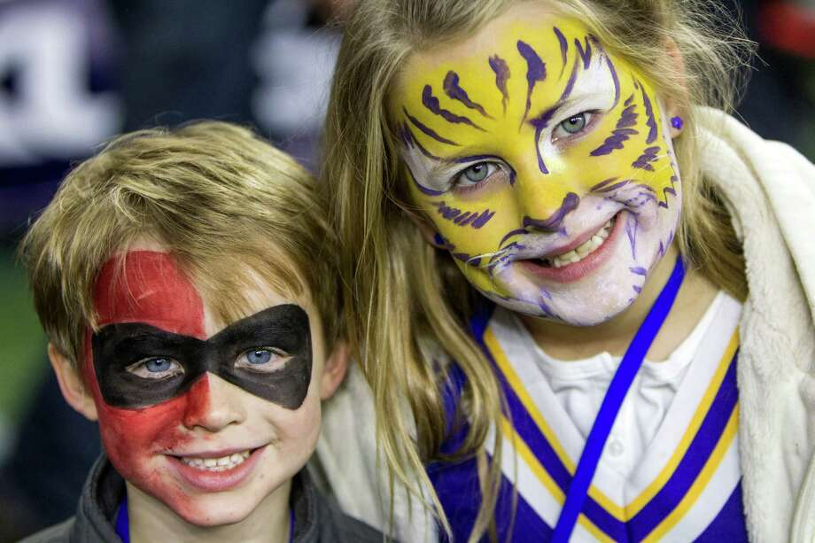 Texas Tech and LSU fans watch warm ups before the AdvoCare V100 Texas Bowl at NRG Stadium on Tuesday, Dec. 29, 2015, in Houston. Photo: Brett Coomer, Houston Chronicle / © 2015 Houston Chronicle