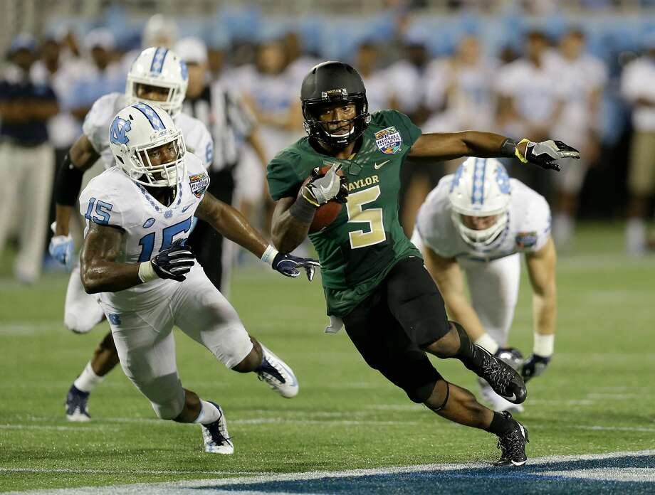 Baylor's Johnny Jefferson scores one of his three touchdowns. He ran for 299 yards, which was less than half the Bears' total. Photo: John Raoux, Associated Press