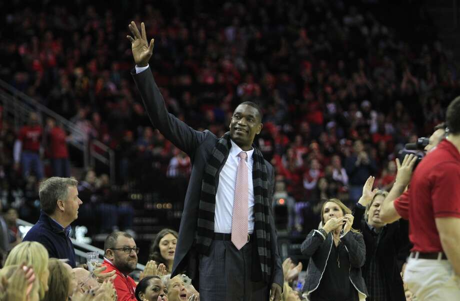 Former Rocket and second-all-time leading shot-blocker Dikembe Mutombo receives a standing ovation during the first half of the Houston Rockets game against the Atlanta Hawks, Tuesday, Dec. 29, 2015, in Houston. ( Mark Mulligan / Houston Chronicle ) Photo: Mark Mulligan, Houston Chronicle