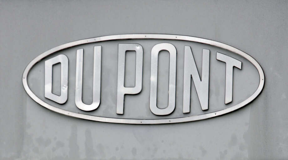 FILE - In this April 22, 2008, file photo, the DuPont logo is seen on a sign at the entrance to the company's Spruance Plant in Richmond, Va. DuPont said Tuesday, Dec. 29, 2015, it will cut 1,700 jobs in its home state of Delaware and thousands more globally as it prepares for its merger with Dow Chemical. (AP Photo/Steve Helber, File) Photo: Steve Helber, STF / AP