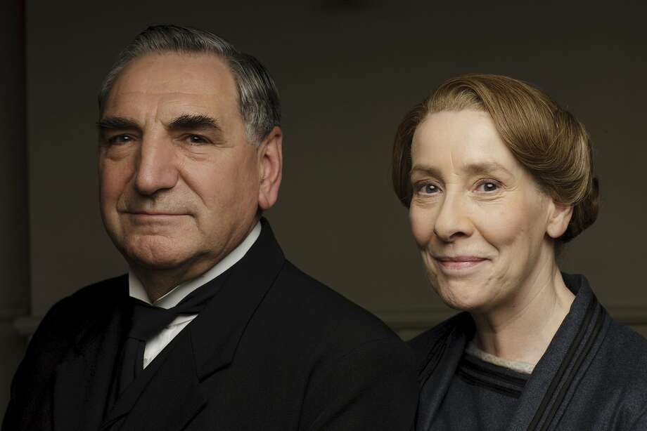 """This photo provided by PBS shows Jim Carter, left, as Mr Carson and Phyllis Logan as Mrs Hughes from series six of """"Downton Abbey."""" """"Downton"""" returns for its sixth and final season, Sunday, Jan. 3, 2016, at 9 p.m. EST on PBS. (Nick Briggs/PBS/Carnival Film & Television Ltd for MASTERPIECE via AP) USE ON THIRD PARTY SITES SUCH AS FACEBOOK AND TWITTER IS NOT ALLOWED. Photo: Nick Briggs, Associated Press"""