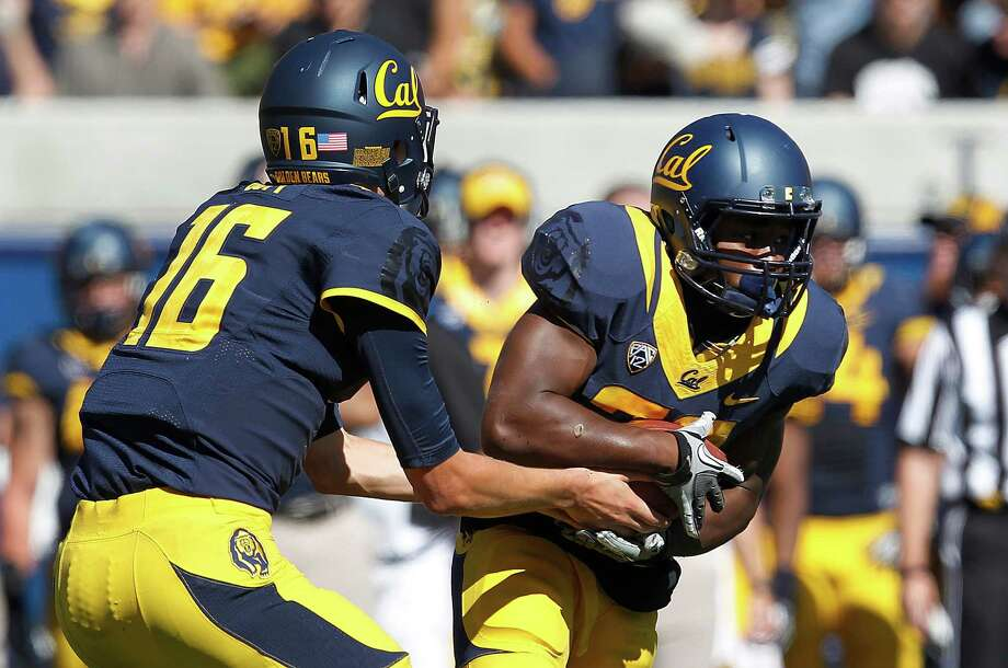 Cal running back Jeffrey Coprich has been granted a sixth year of eligibility.  California quarterback Jared Goff (16) hands off to running back Jeffrey Coprich (30) against Washington State during the first half of an NCAA college football game in Berkeley, Calif., Saturday, Oct. 5, 2013. (AP Photo/Tony Avelar) Photo: Tony Avelar / ONLINE_YES