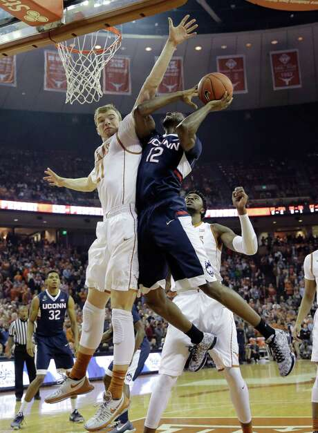 Texas' Connor Lammert gets full extension to challenge a shot by Connecticut's Kentan Facey. Photo: Eric Gay, STF / AP