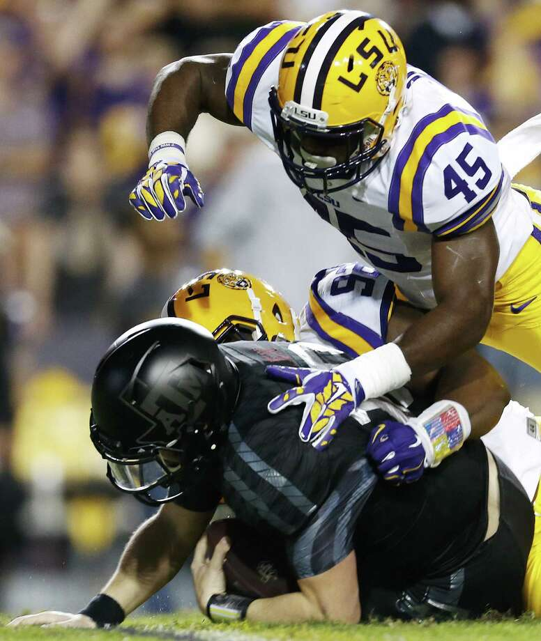 LSU linebacker Deion Jones (45) and defensive end Lewis Neal (92) sack Texas A&M quarterback Kyle Allen (10) during the first half an NCAA college football game in Baton Rouge, La., Saturday, Nov. 28, 2015. (AP Photo/Jonathan Bachman) Photo: Jonathan Bachman, FRE / FR170615 AP