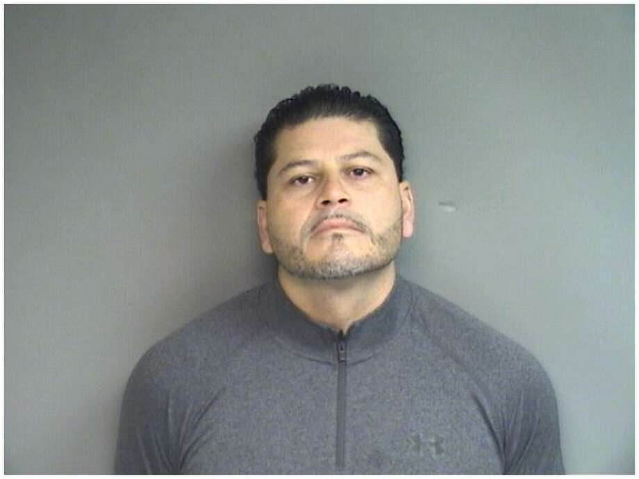 Lenin Flores, 39, of Stamford, was charged by police with molesting a 13-year-old girl earlier this year and held on a $50,000 court appearance bond. Photo: Stamford Police