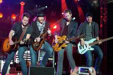 Eli Young Band rock out during the Eli Young Band House Party at Minute Maid Park late last year. The Denton-based country group plays Cowboys Dancehall Saturday.
