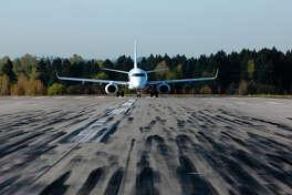 A jet on at runway at Sea-Tac Airport.
