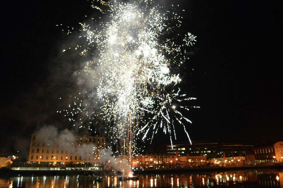 Fireworks were launched from a barge over the banks of the Saugatuck River, capping the 2015 First Night celebration in Westport. Photo: File Photo / Westport News