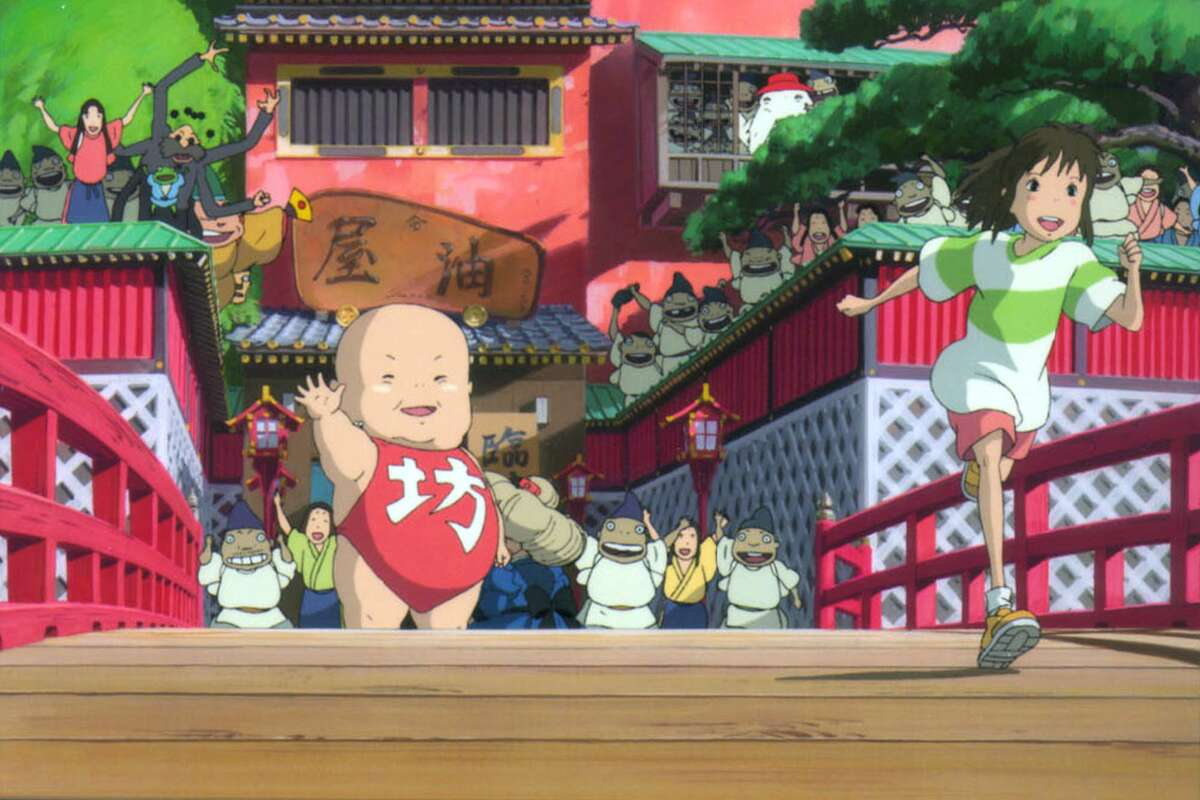 """Yubaba's giant baby boy, Boh, and the workers at the bathhouse give Chihiro a big send-off in """"Spirited Away,"""" a animation by acclaimed Japanese filmmaker Hayao Miyazaki."""