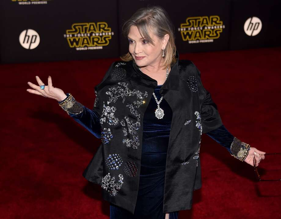 Carrie Fisher attends the premiere of Walt Disney Pictures and Lucasfilm's 'Star Wars: The Force Awakens' at the Dolby Theatre on December 14, 2015 in Hollywood, California. See who else was spotted on the red carpet.
