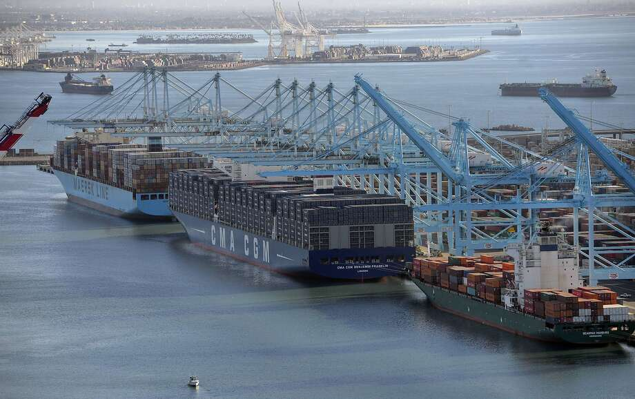 The CMA CGM Benjamin Franklin, the largest container ship to ever call at a North America port, is docked at the Port of Los Angeles in San Pedro, California, after arriving before dawn December 26, 2015.  Launched by the French shipping line CMA CGM S.A. on December 10, the CMA CGM Benjamin Franklin is 1,300 feet (396 meters) long, 177 feet (54 meters) wide, and 197 feet (60 meters) tall and has a capacity of approximately 18,000 containers. Photo: Scott Varley, AFP / Getty Images