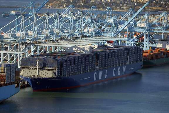 The largest container ship to ever make port in North America unloads its cargo in the Port of Los Angeles in San Pedro, Calif., on Saturday, Dec. 26, 2015. After making its maiden voyage from China, where it was built, the  CMA CGM Benjamin Franklin arrived before dawn with its cargo. The ship can carry 18,000 twenty-foot equivalent units (TEUs), which is about a third more than the ships that currently dock in the Port of L.A. The vessel measures 1,300 feet long, 177 feet wide and is 197 feet tall and is staffed with a crew of 26. The giant ship is scheduled to leave Los Angeles on Wednesday, December 30 en route to Oakland before returning to China.  (Scott Varley/ The Daily Breeze via AP, Pool)