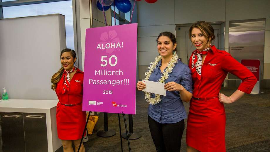 Katheryn Castanga, of Arlington, Va. (center), was S.F. International Airport's 50 millionth passenger in 2015, earning her two round-trip tickets to Hawaii. Photo: Peter_Biaggi, S.F. International Airport