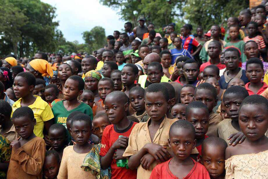 Burundian refugees attend a rally at a refugee camp in Kigoma, Tanzania. More than 100,000 Burundians have fled to neighboring countries. Photo: Stringer, Associated Press
