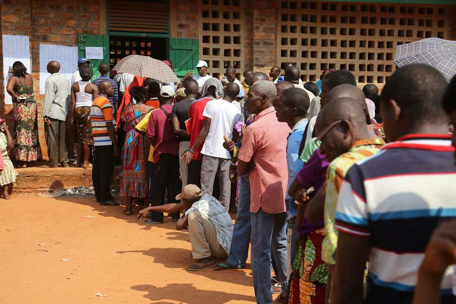 People stand in line outside a polling station to cast their ballots during elections in the capital, Bangui. Photo: Herve Serefio Diaspora, Associated Press