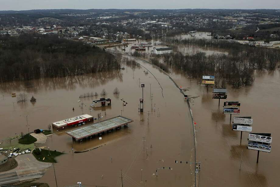 A QuikTrip gas station is flooded in Union, Mo. Forecasts are calling for record or near-record crests of the Mississippi River. Photo: Huy Mach, McClatchy-Tribune News Service