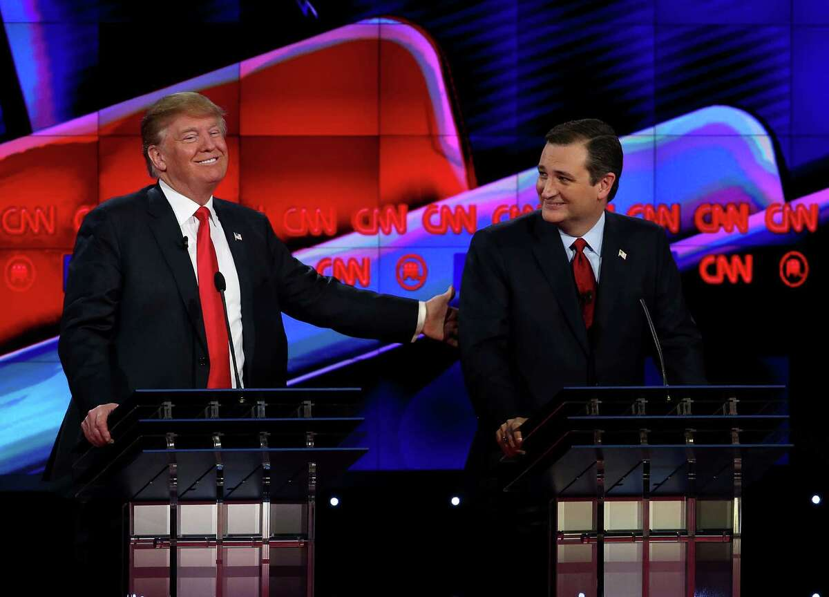 Donald Trump and Sen. Ted Cruz are shown at the Republican presidential debate in Las Vegas on Dec. 15. Continue clicking to see the Ted Cruz birther controversy explained.