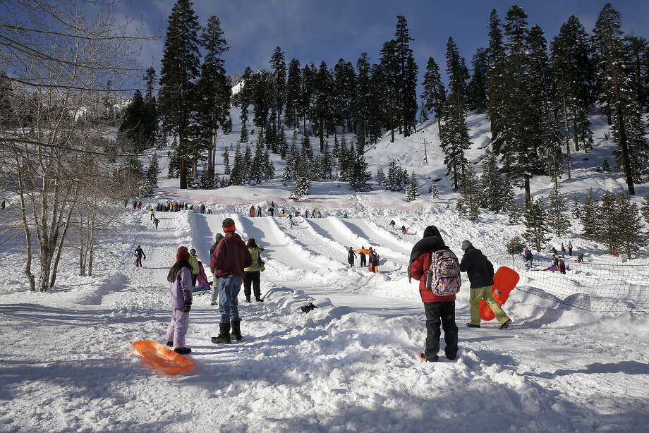 Visitors to the Adventure Mountain snow park at Echo Summit, Calif. enjoy the snow as the the first snow survey of the season was taken along highway 50 at Phillips Station, Calif., on Wednesday December 30, 2015. After the survey it was determined that the snow pack is at 137% of the historical average for readings taken on January 1 at the Phillips location. Photo: Michael Macor, The Chronicle