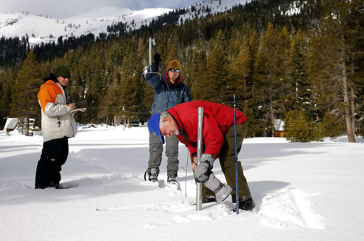 Frank Gehrke, (right) chief of snow surveys for the California Department of Water along with John King, (center) also with DWR and Frank Anderson, (left) with USGS collect samples during the first snow survey of the season, at Phillips Station, Calif., on Wednesday December 30, 2015. After the survey it was determined that the snow pack is at 137% of the historical average for readings taken on January 1 at the Phillips location.