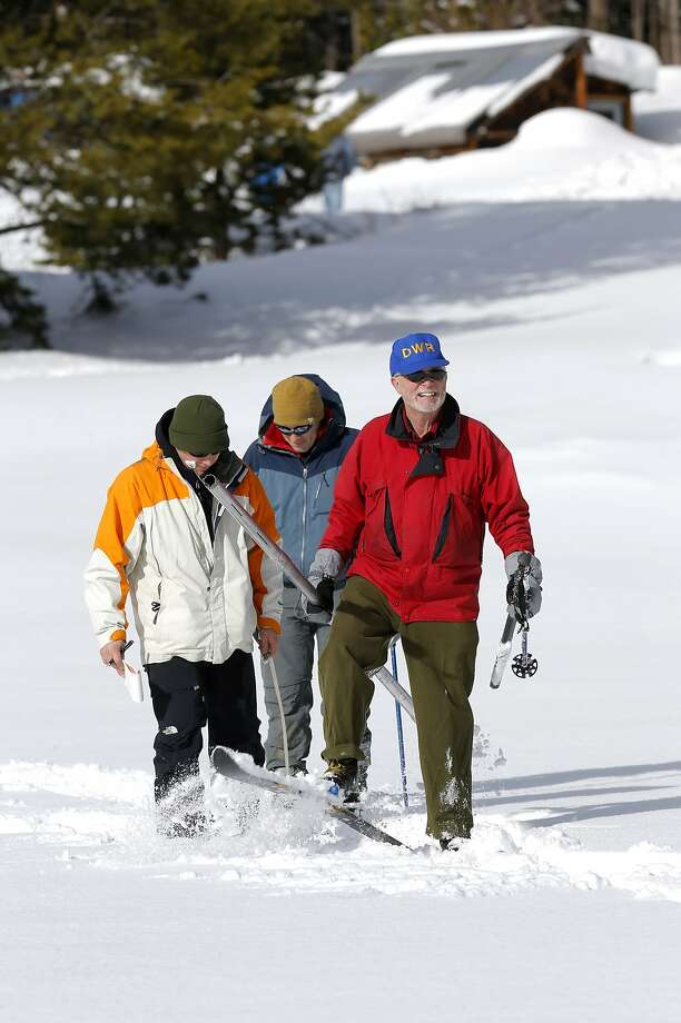 Frank Gehrke, (right) chief of snow surveys for the California Department of Water Resources along with John King, (center) also with DWR and Frank Anderson, (left) with USGS make their way through the snow to collect samples during the first snow survey of the season, at Phillips Station, Calif., on Wednesday December 30, 2015. After the survey it was determined that the snow pack is at 137% of the historical average for readings taken on January 1 at the Phillips location. Photo: Michael Macor, The Chronicle