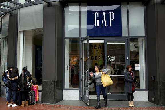 A shopper walks out of Gap on Market Street in San Francisco, California, on Wednesday, Dec. 30, 2015.