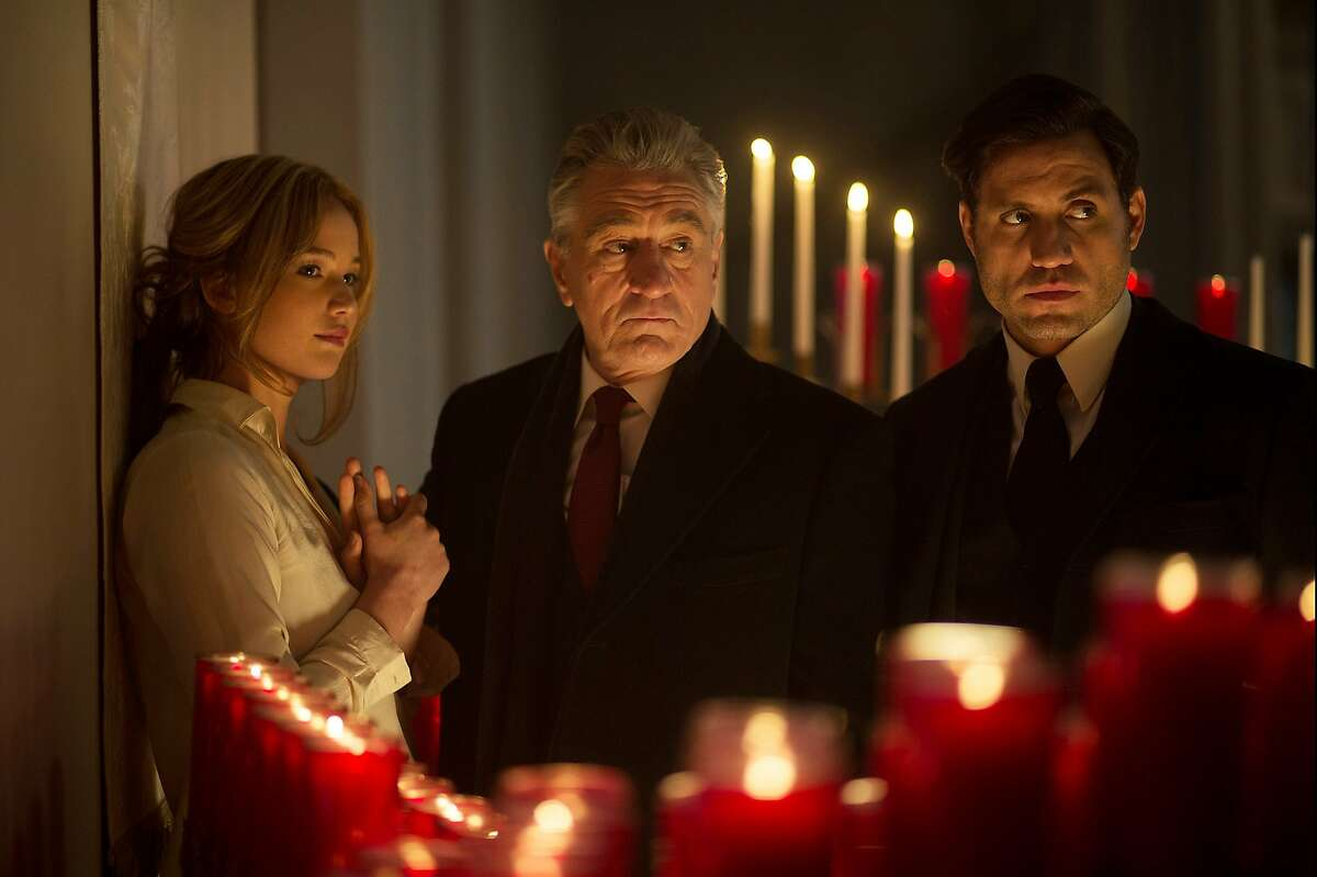 """This photo provided by Twentieth Century Fox shows, Jennifer Lawrence, from left, Robert De Niro, and Edgar Ramirez, in a scene from the film, """"Joy."""" The movie opens in U.S. theaters on Dec. 25, 2015. (Merie Weismiller Wallace/Twentieth Century Fox via AP)"""
