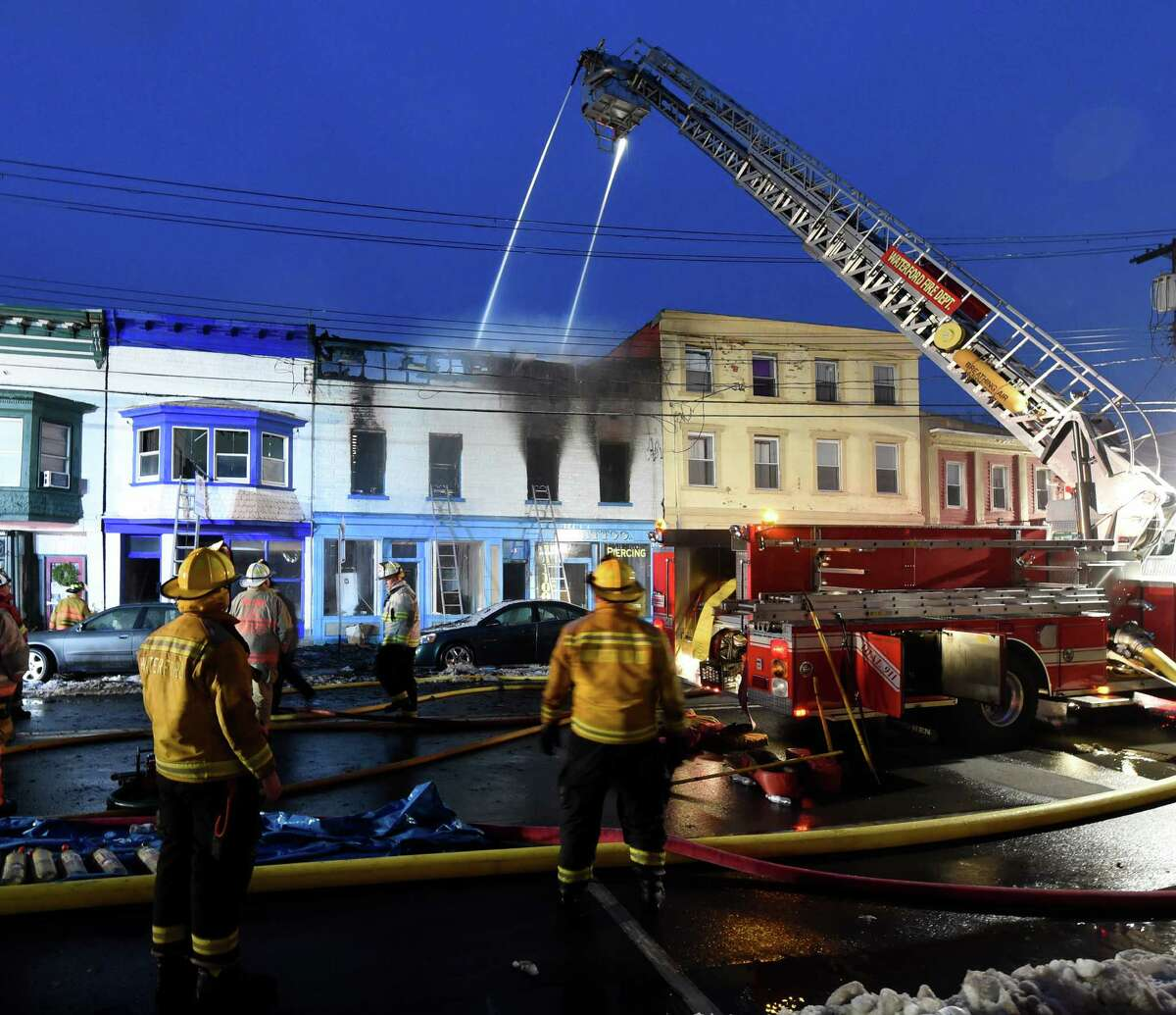 Firefighters from two counties work on a mutual aid fire which started in 33 Broad St. early Wednesday Dec. 30, 2015 in Waterford, N.Y. (Skip Dickstein/Times Union)