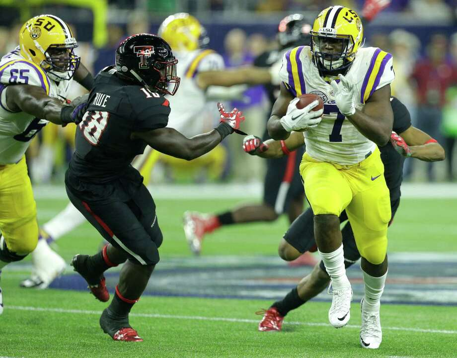LSU running back Leonard Fournette (7) breaks past Texas Tech linebacker Micah Awe (18) on his way to a 43-yard touchdown run during the third quarter of the AdvoCare V100 Texas Bowl at NRG Stadium on Tuesday, Dec. 29, 2015, in Houston. ( Brett Coomer / Houston Chronicle ) Photo: Brett Coomer, Staff / © 2015 Houston Chronicle