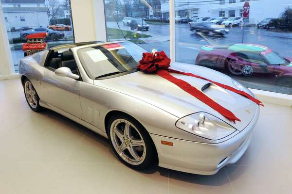 The Miller Motorcars dealership on West Putnam Avenue in Greenwich had a 2005 Ferrari Superamerica convertible on display before Christmas. Car dealerships are closing in on a record year for new car sales in Connecticut.