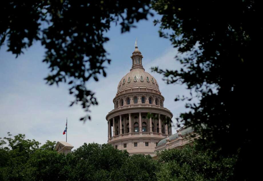 In This July 30, 2013, file photo, the dome of the Texas State Capital is seen through trees on the final day of a special session, in Austin, Texas. State regulators are looking to tighten rules for lobbyist-paid junkets for lawmakers and state officials. Photo: Eric Gay, STF / AP