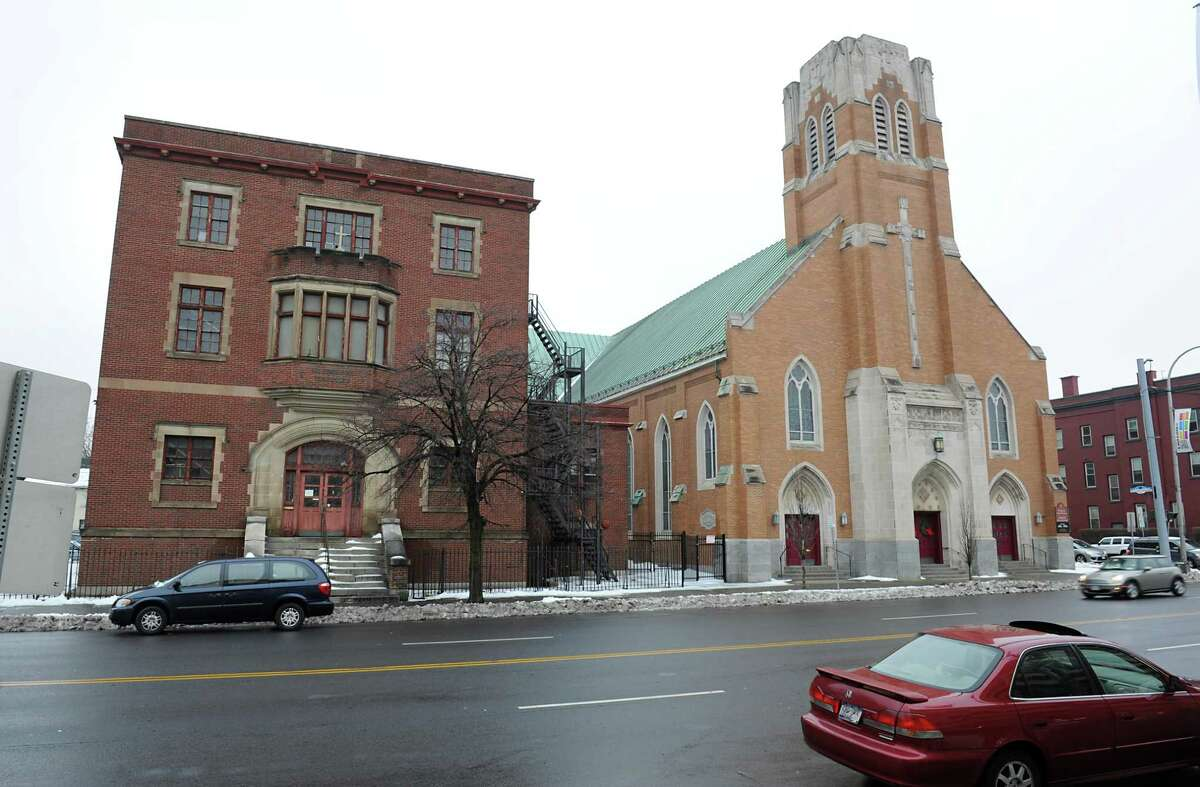 The former St. Patrick's Catholic school, at left, on Central Ave. Wednesday, Dec. 30, 2015 in Albany, N.Y. The building will be an incubator tech start-up called the S.T.E.A.M. Garden thanks to $850,000 in state grants to the Cetnral Avenue BID. The BID bought the long-closed school from the Albany Catholic diocese for $200K in 2011.(Lori Van Buren / Times Union)