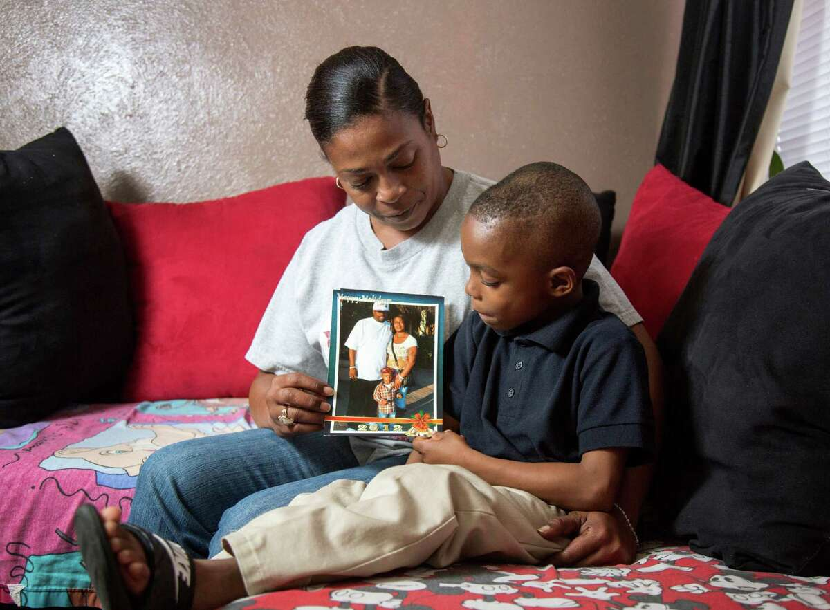 Christie Collins poses for a portrait with her son Cedric Collins, III, Thursday, Oct. 29, 2015, in Dallas. Her late husband, Cedric Collins, Jr. died from injuries sustained in a car accident after he was initially taken to Harris County jail instead of the hospital.