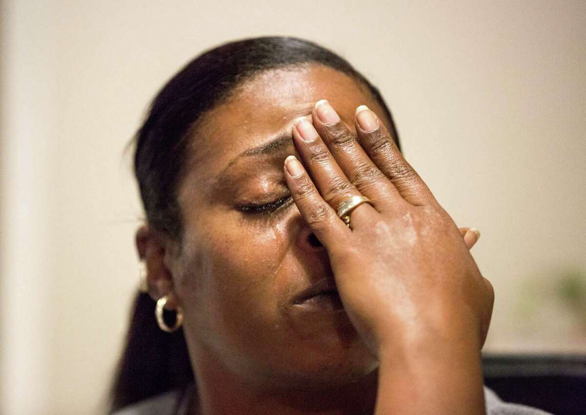 Christie Collins reacts as she recounts her husband's death.
