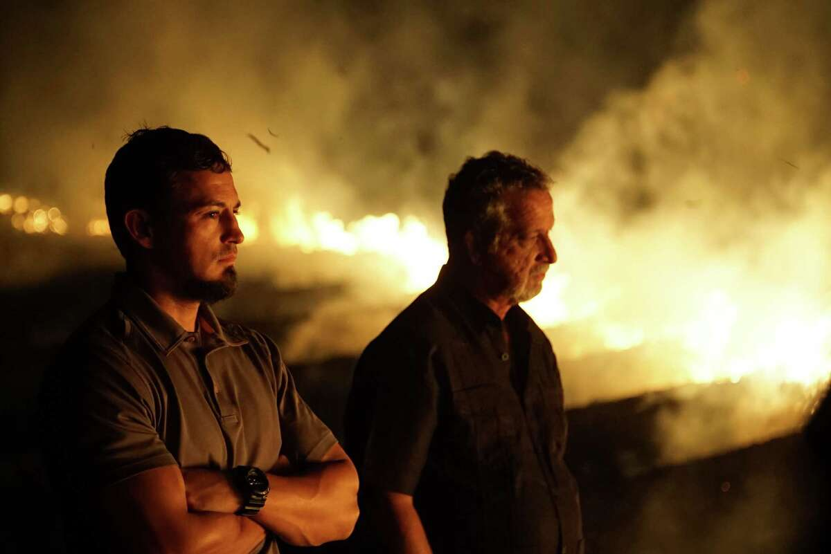 Close up of Retired Detective Rhodes Sanchez and Detective Aubrey St. Angelo at burning sugar cane field. Close up of Retired Detective Rhodes Sanchez and Detective Aubrey St. Angelo at burning sugar cane field.