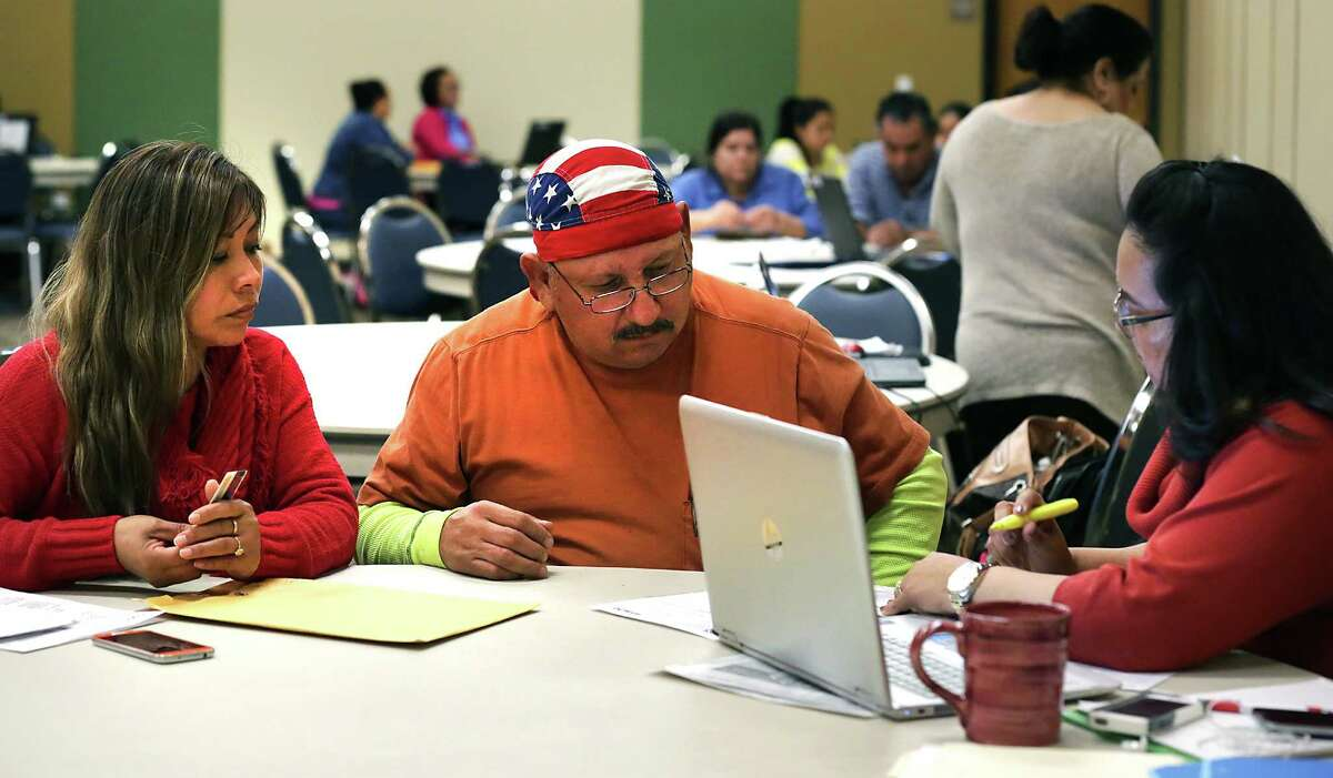 Isabel Montalvo (left) and her husband, Eraldo Montalvo, examined their 2016 health insurance options during a recent enrollment event at CentroMed's Southside Medical Clinic in San Antonio. Maria Lee helped them navigate the federal marketplace to find options.
