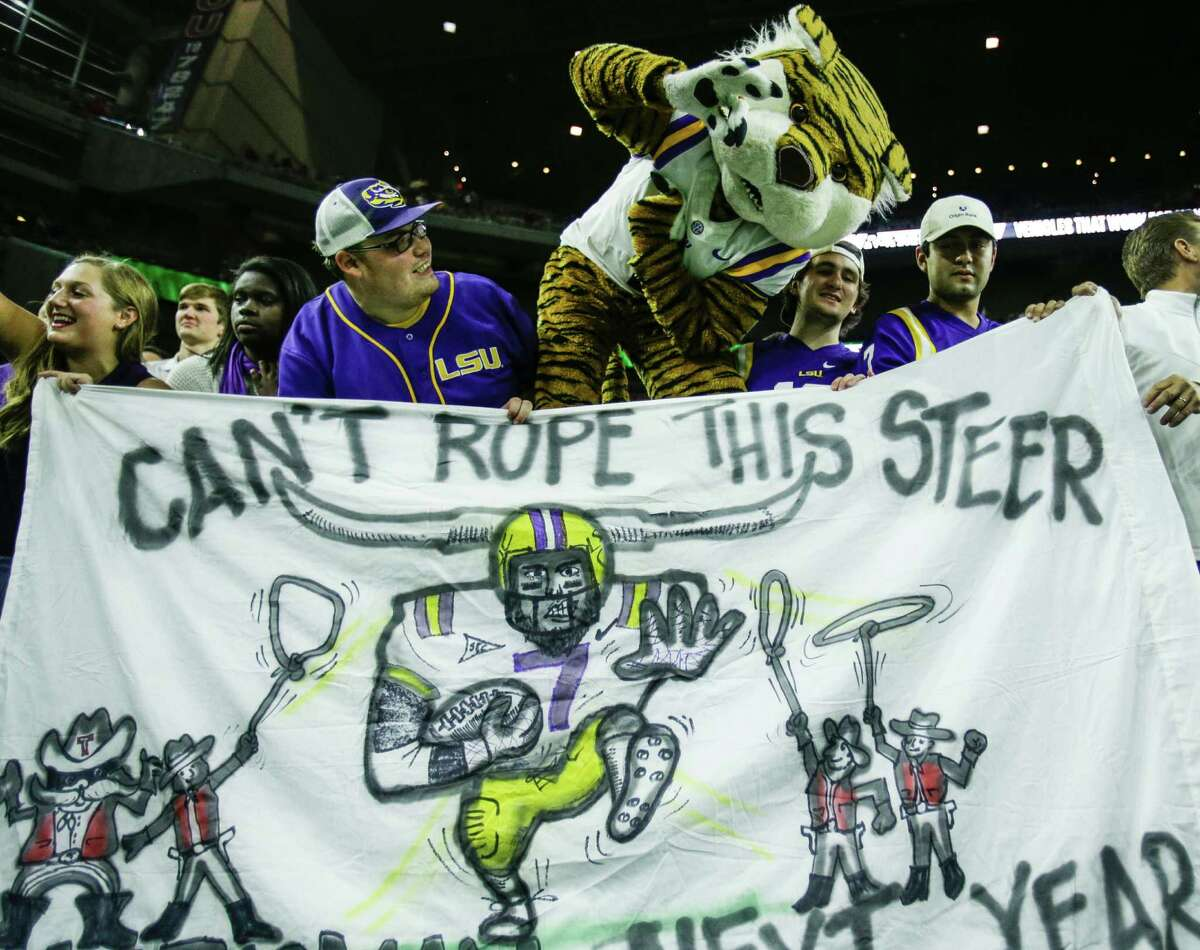 The LSU mascot celebrates with Tiger fans after a 56-27 win over Texas Tech in the AdvoCare V100 Texas Bowl at NRG Stadium on Tuesday, Dec. 29, 2015, in Houston.