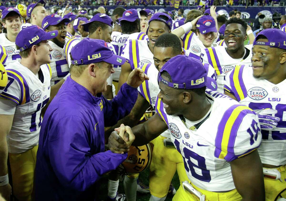 LSU head coach Les Miles and LSU cornerback Tre'Davious White (18) celebrate LSU's 56-27 win over Texas Tech in the AdvoCare V100 Texas Bowl at NRG Stadium on Wednesday, Dec. 30, 2015, in Houston.
