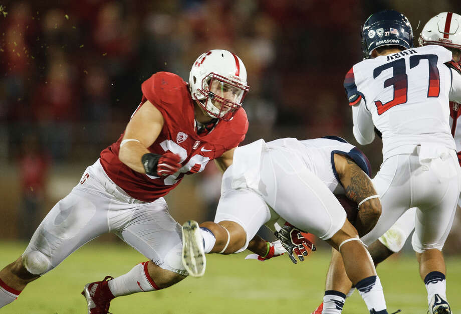 Craig Jones prepares to make a tackle in the Cardinal's rout of Arizona in October. Jones is a key member of Stanford's punt- and kickoff-coverage teams. Photo: David Elkinson / David Elkinson/Stanfordphoto.com / Stanfordphoto.com