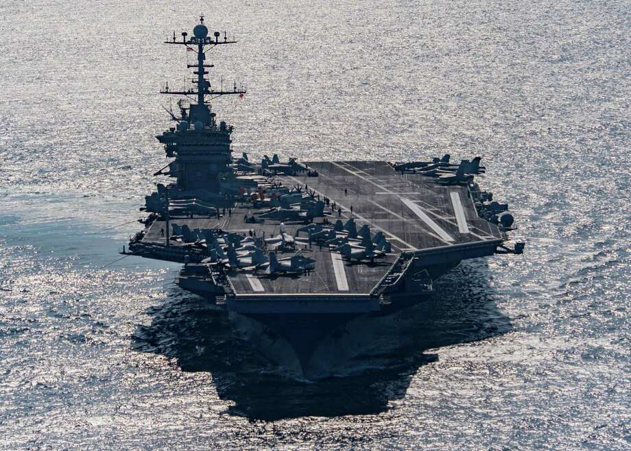 In this Friday, Dec. 25, 2015 photo released by the U.S. Navy, the aircraft carrier USS Harry S. Truman navigates the Gulf of Oman. Iranian naval vessels conducted rocket tests last week near the USS Harry S. Truman aircraft carrier, the USS Bulkeley destroyer and a French frigate, the FS Provence, and commercial traffic passing through the Strait of Hormuz, the American military said Wednesday, Dec. 30, 2015 causing new tension between the two nations after a landmark nuclear deal. (Mass Communication Specialist 3rd Class J. M. Tolbert/ U.S. Navy via AP) MANDATORY CREDIT Photo: Mass Communication Specialist 3r, HOGP / U.S. Navy