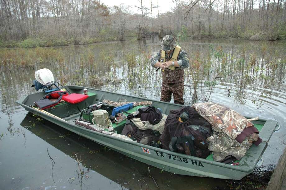 Winter weather can create dangerous conditions for waterfowlers, requiring they religiously practice safe boating practices such as wearing a personal flotation device any time they are in a boat. Photo: TOM BEHRENS / handout